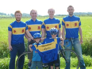 Team Thurnham Cycles – the team that I'm an honorary member of. From left to right, David Holme, Andy Holme, Gareth Holme and Andrew Holme. All of them triathletes. In the front is the next generation of the team, Thomas and Joseph. (Courtesy of Andy Holme)